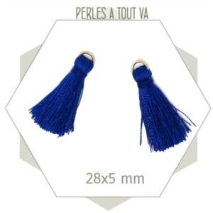 10 pompons bleus 28x5mm avec anneau